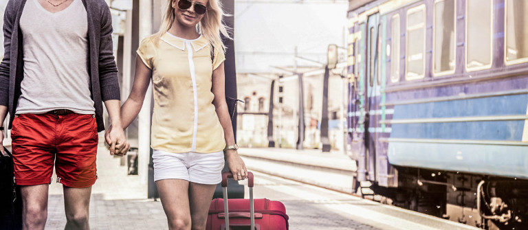 young-couple-waiting-for-a-train-on-platform-istock_000031131506_large-2-1200×335