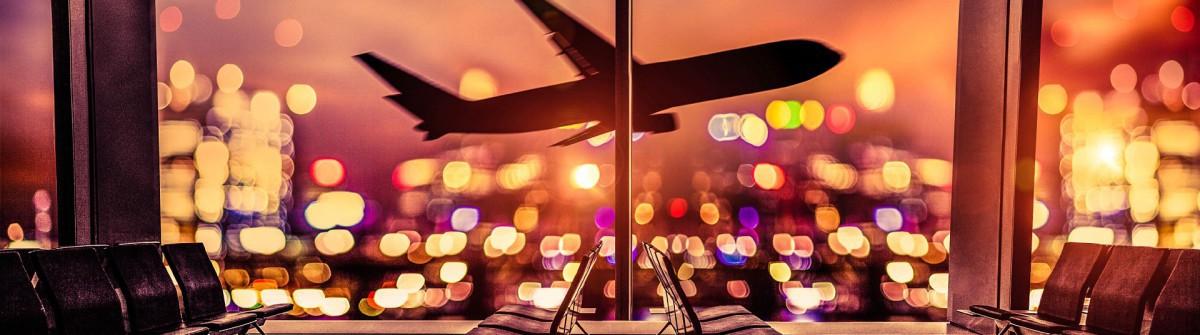 flughafen-lounge-und-flugzeug-fliegen-sie-in-der-stadt-istock_000081873381_large-2-1200×335-1
