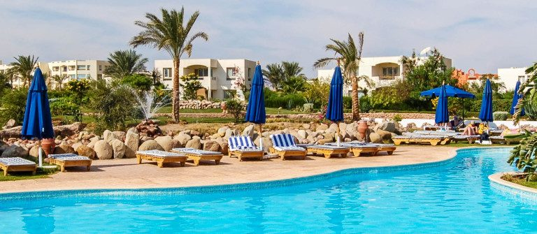 swimming-pool-at-popuar-hotel-sharm-el-sheikh-egypt-shutterstock_29834413-2-1200×335