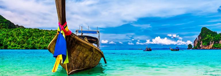 Long-boat-and-tropical-beach-Andaman-Sea-Thailand-iStock_000059875844_Large-2