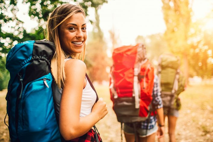 Young Women Hiking In Nature.
