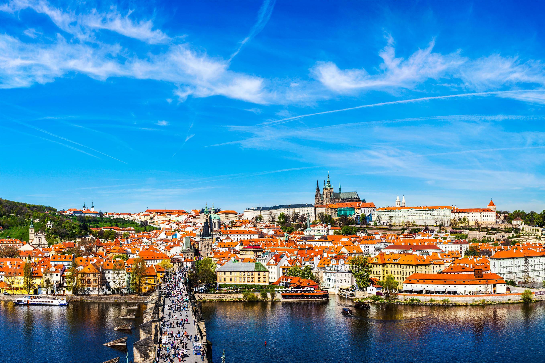 Prague: Mala Strana, Charles bridge and Prague castle view from Old Town bridge tower over Vltava river in daytime. Prague, Czech Republic
