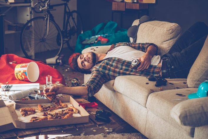 hangover_man-lying-on-the-couch_shutterstock_393544207