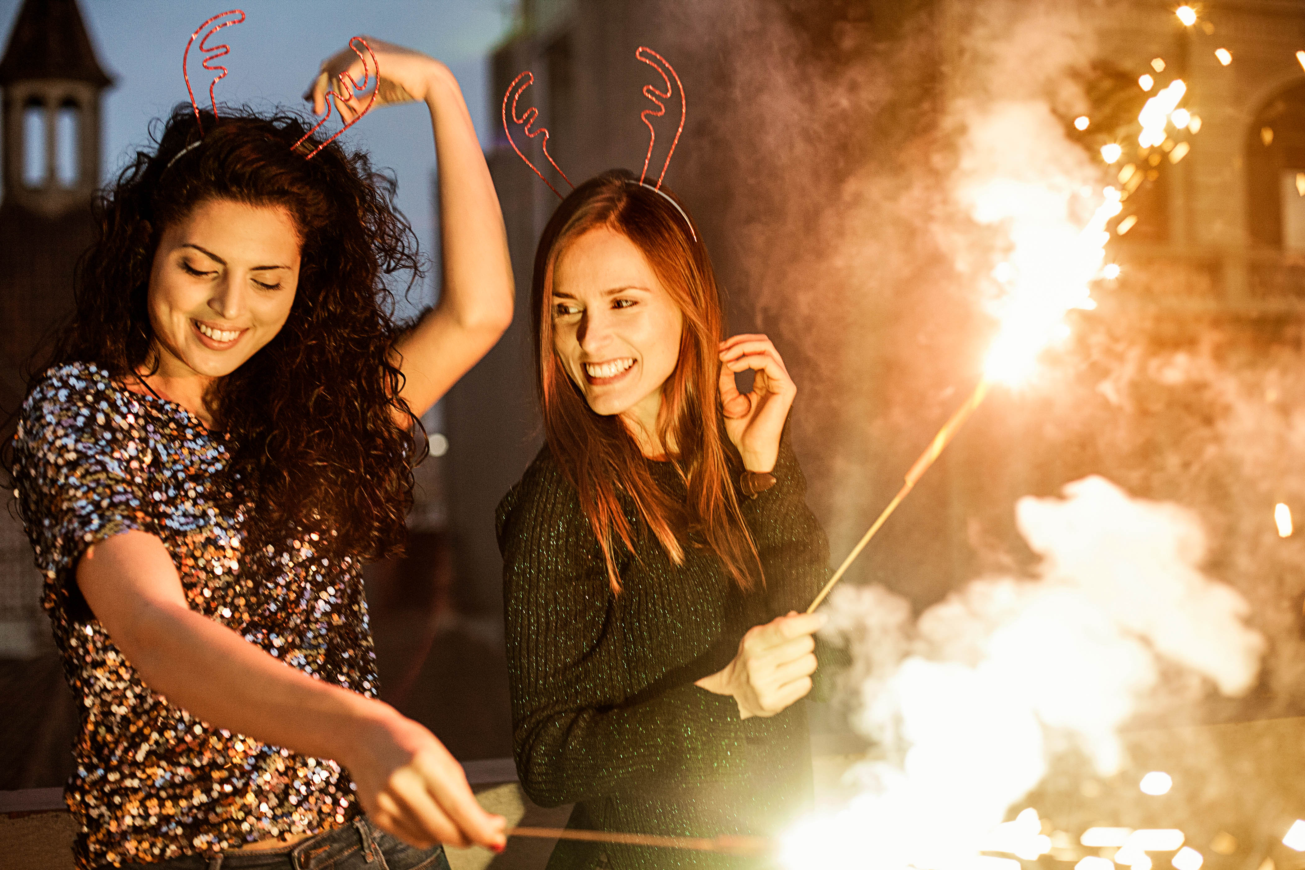 Friends with sparklers celebrating christmas