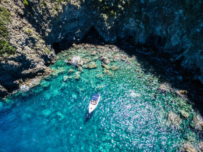 Ischia, lonely boat in a turquoise Naples, Italyshutterstock_469607711-2
