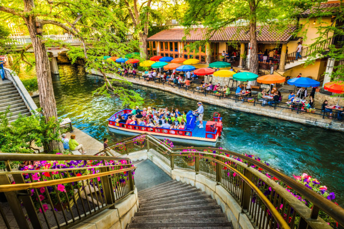 the-riverwalk-san-antonio-park-walkway-scenic-canal-tour-boat-istock_000052283438_large-editorial-only-david-sucsy-2