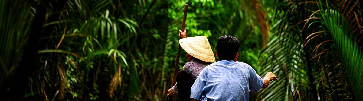 vietnamese-people-paddling-in-the-mekong-river-vietnam-shutterstock_106635710-2