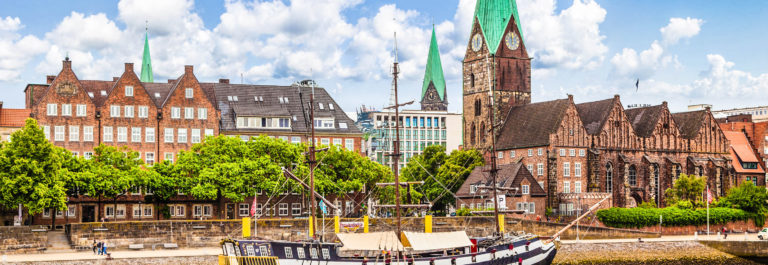 Historic town of Bremen with old sailing ship on Weser river, Germany shutterstock_231373708-2