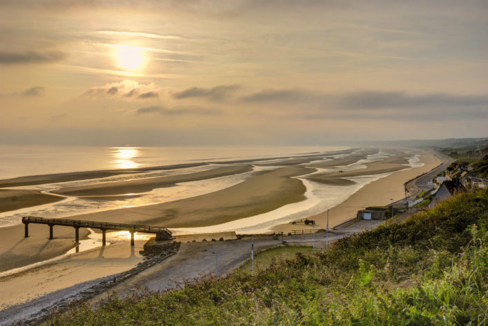 omaha-beach-at-sunrise-shutterstock_122760202-2