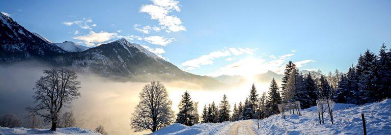 Winter landscape with icy road near Salzburg in Austria, Europe