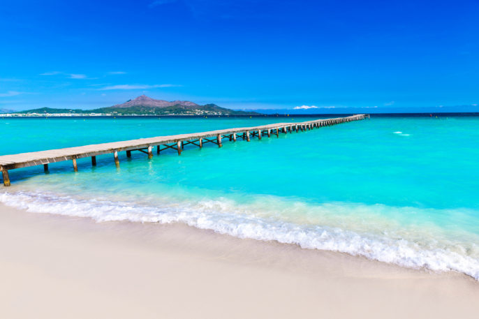 majorca-platja-de-muro-beach-pier-in-alcudia-bay-in-mallorca-balearic-islands-of-spain-shutterstock_270339830-2