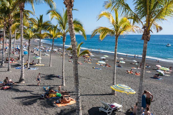 Sunbathing people at beach La Palma Island, Spain