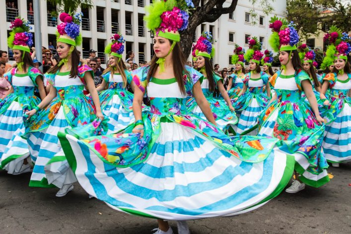 Young women dancing in the Madeira Flower Festival, Funchal, Portugal.