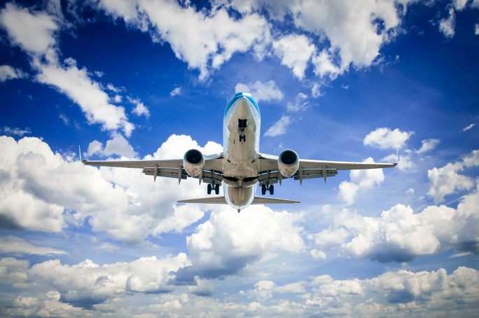 Airplane-flying-in-the-blue-sky-with-clouds-iStock_27146639_LARGE-2