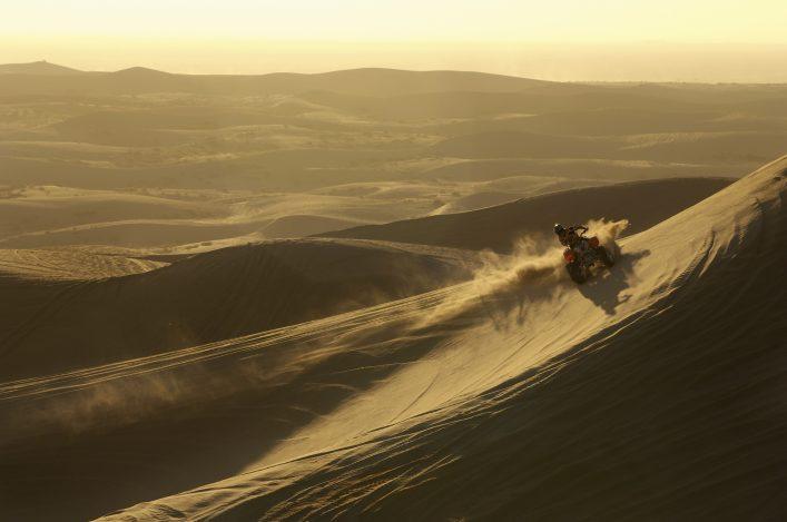 Man-riding-quad-bike-in-desert-at-sunset_shutterstock_110354942_klein
