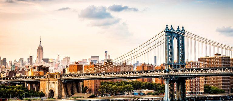Manhattan Bridge and the New York skyline before sunset