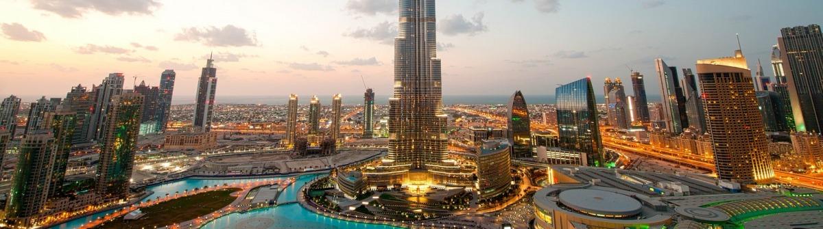 City lights in Dubai at sunset