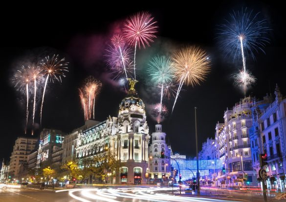 Night-photography-of-Madrid-cityscape-fireworks-display-celebration-Gran-Via-street-with-rays-of-traffic-light.-Madrid-Spain._shutterstock_544454410-zugeschnitten-1