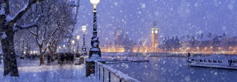 Snowing on Jubilee Gardens in London at dusk