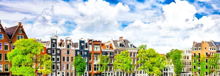 amsterdam-with-canal-in-the-downtown-holland-istock_000030442394_large-2