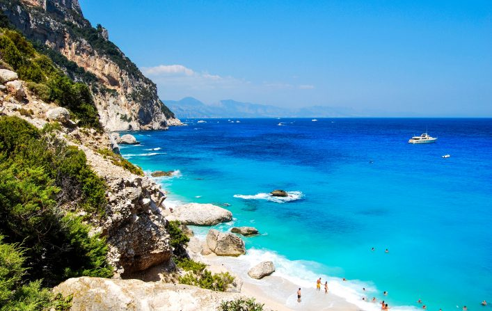 blue-beach-with-some-people-seen-from-top-cala-goloritze-sardinia-italy-istock_000069297683_large-2