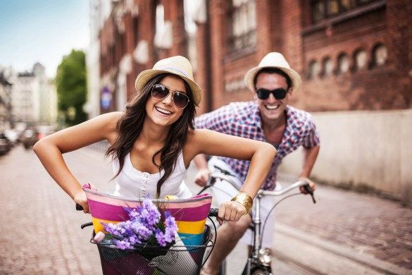 happy-couple-cycling-in-the-city-shutterstock_145149241-2