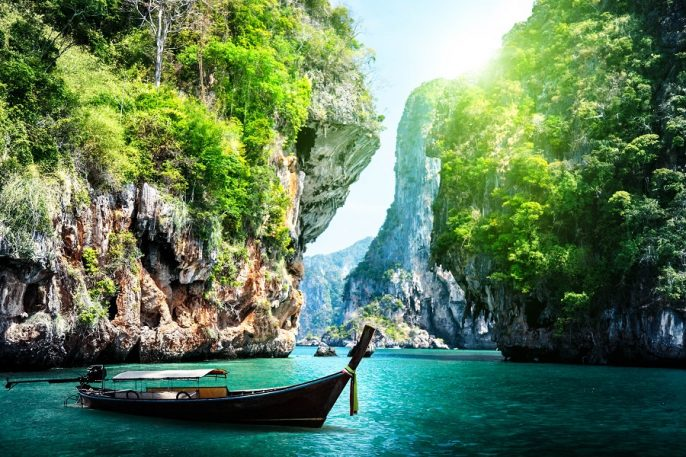 long-boat-and-rocks-on-railay-beach-in-krabi-thailand-shutterstock_125319602-2