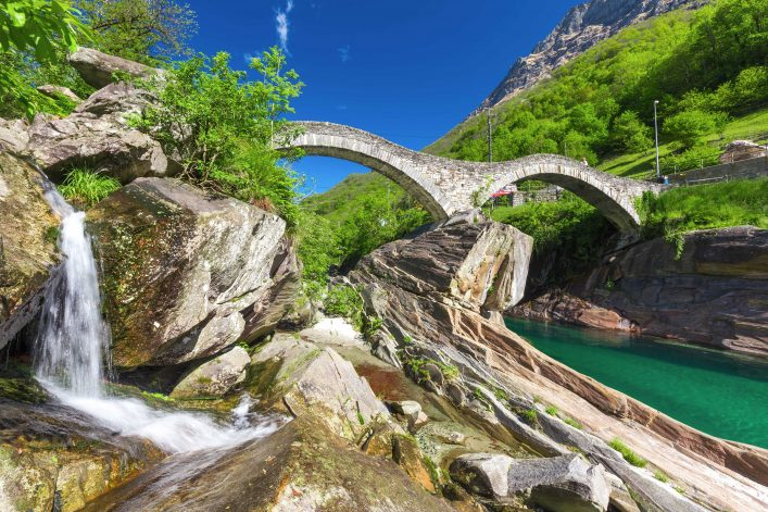 double-arch-stone-bridge-at-ponte-dei-salti-with-waterfall-lavertezzo-verzascatal-canton-tessin-shutterstock_430079833-2