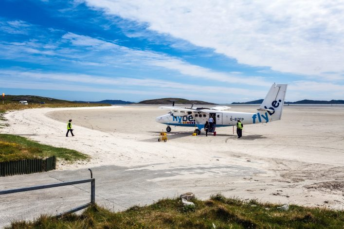 Flybe airplane on the sandy runway of Barra airport, Outer Hebrides of Scotland shutterstock_244123117-2