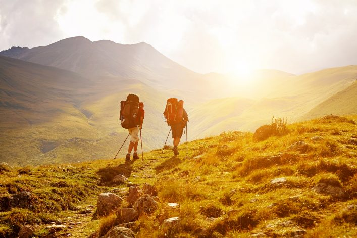 Hikers-on-the-trail-in-the-Caucasian-mountains.-Trek-to-Kazbek-mount-shutterstock_265011137