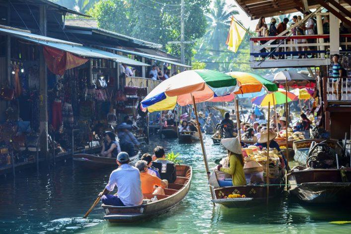 Damnoen-Saduak-Floating-Market-tourists-visiting-by-boat-located-in-Bangkok-Thailand.