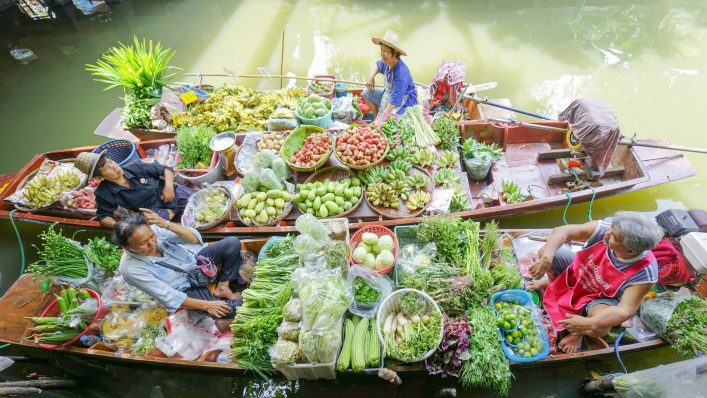 EDITORIAL-ONLY-Sanit-Fuangnakhon.-Floating-market-Traders.-shutterstock_608766473