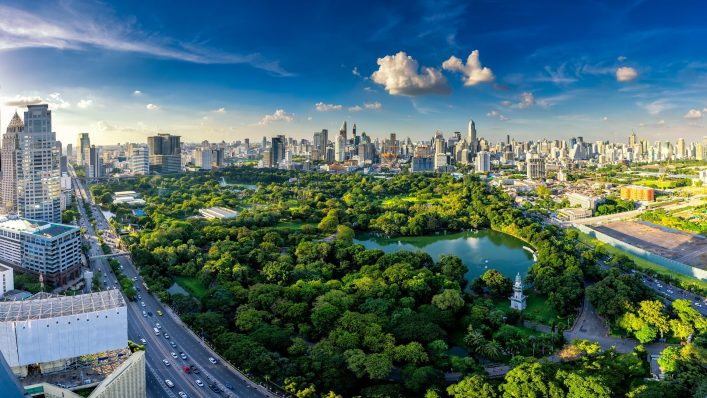 Sunset-scence-of-modern-office-buildings-and-condominium-in-Bangkok-city-downtown-with-sunset-sky-and-clouds-at-Bangkok-Thailand.-Lumpini-park-shutterstock_748811014