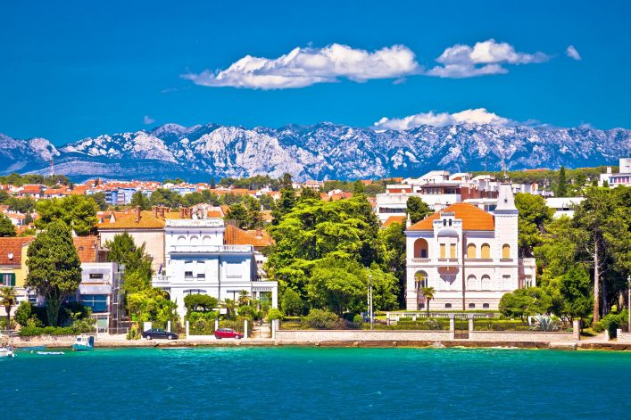 Zadar coast villas ann Velebit mountain background, Dalmatia, Croatia