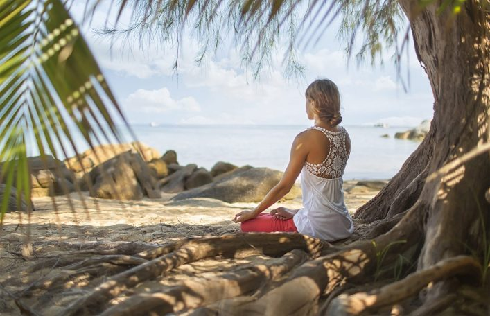 Meditation.-photo-of-a-woman-who-is-sitting-in-the-lotus-position_shutterstock_261195263-e1534849883951