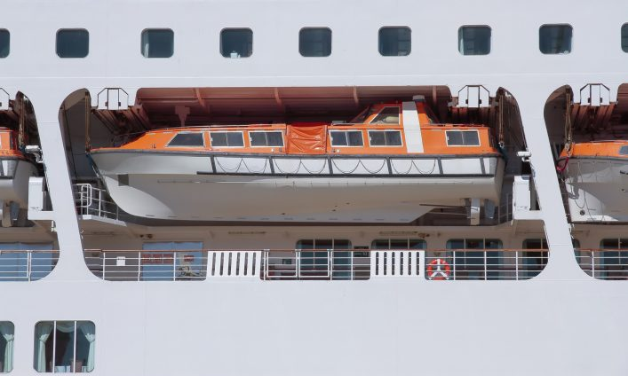 foreground of an orange lifeboat