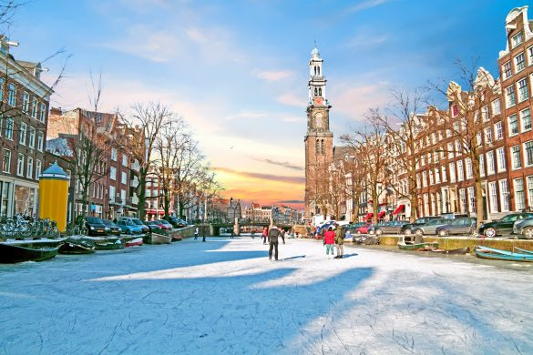Amsterdam-in-winter-with-the-Westerkerk-in-the-Netherlands-at-sunset-shutterstock_731345518