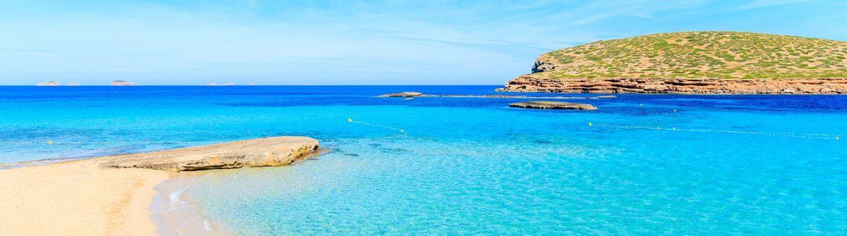 Beautiful-sandy-Cala-Comte-beach-with-azure-blue-sea-water-Ibiza-island-Spain-shutterstock_650392843