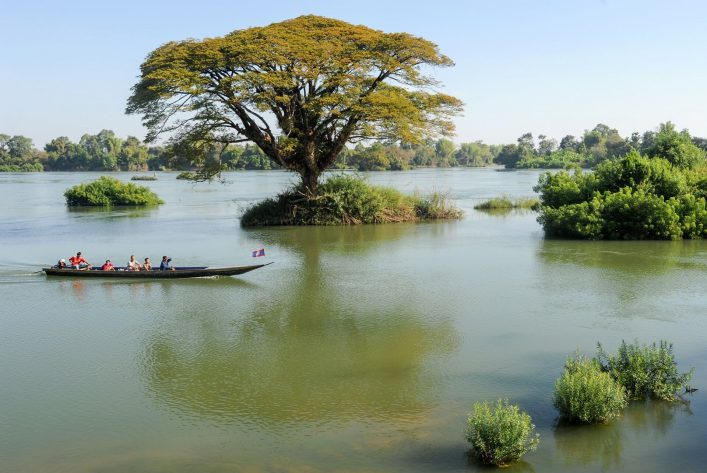 EDITORIAL-ONLY-Stefano-Ember.-people-cruising-on-them-boat-in-river-Mekong-at-Don-Det-Laos.-shutterstock_564549667