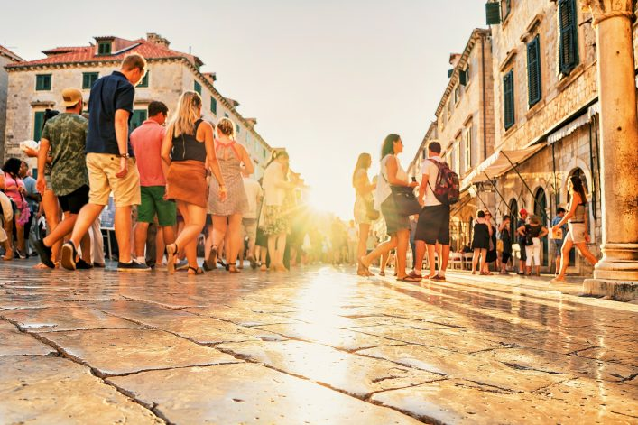 Crowds of tourists at Stradun Street in Dubrovnik at sunset