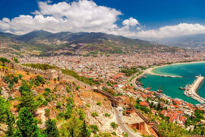 Landscape-with-marina-and-Kizil-Kule-tower-in-Alanya-peninsula-Antalya-district-Turkey-Asia.-Famous-tourist-destination-with-high-mountains.-Part-of-ancient-old-Castle.-Sumshutterstock_626574566