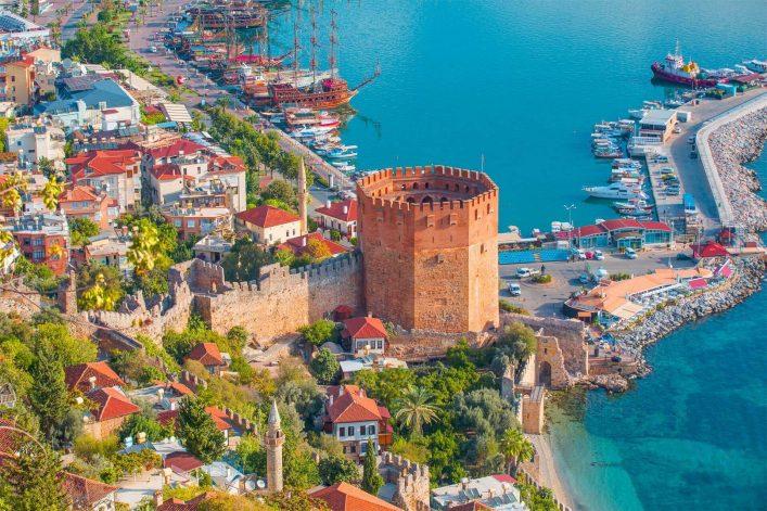 Landscape-with-marina-and-Kizil-Kule-tower-in-Alanya-peninsula-Antalya-district-Turkey-shutterstock_538754155