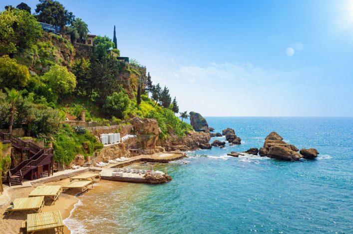 Mermerli-beach-with-clear-blue-water-in-old-town-Kaleici-district-in-popular-seaside-resort-city-Antalya-Turkey-shutterstock_790922134