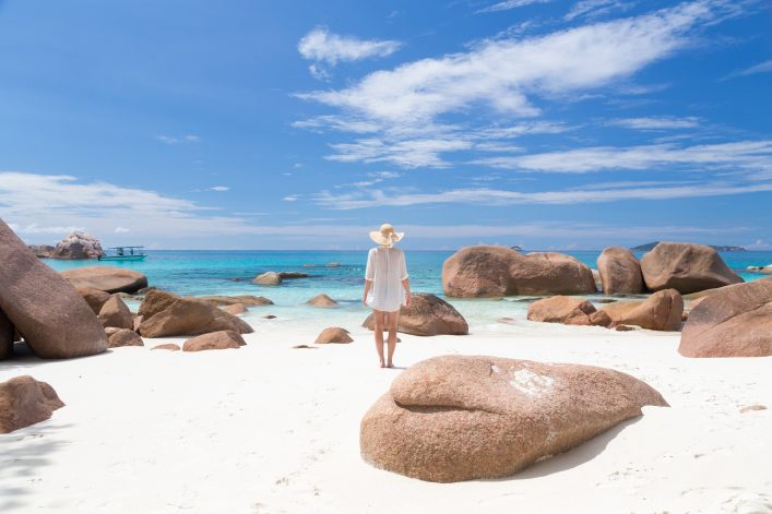 Woman enjoying Anse Lazio picture perfect beach on Praslin Island