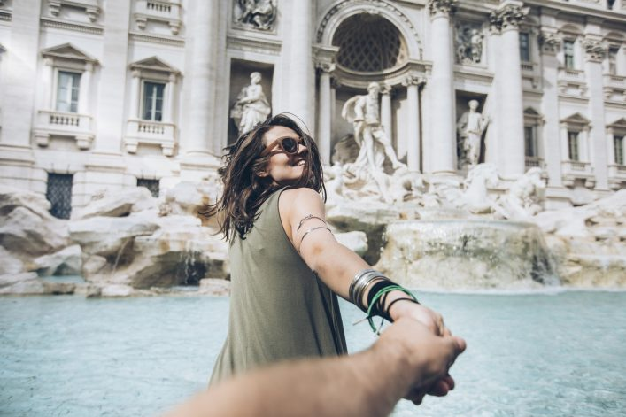Young woman in front of Trevi fountain