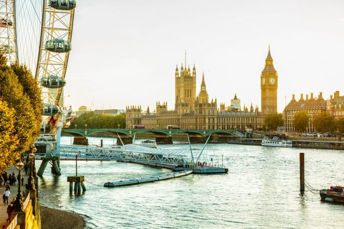 Houses of Parliament, Big Ben and London Eye in London, England.