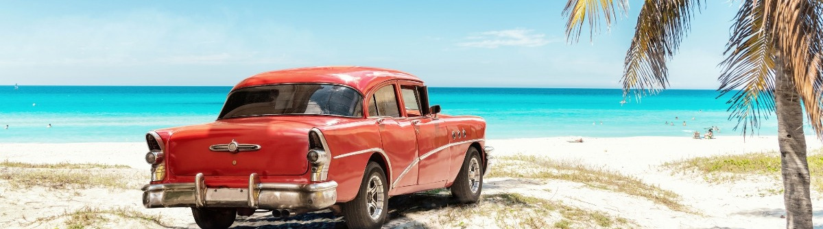 old red american car on Varadero Beach in Cuba