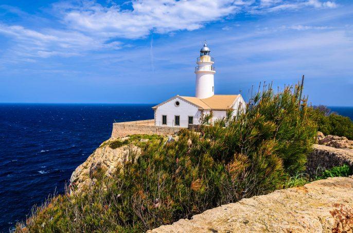 White-building-lighthouse-cliff-sea-view-Cala-Ratjada-Majorca-island-Spain-shutterstock_143327527-2