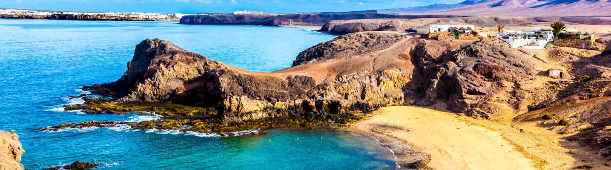 playa-de-papagayo-parrots-beach-on-lanzarote-canary-islands-istock_000022056488_large-2