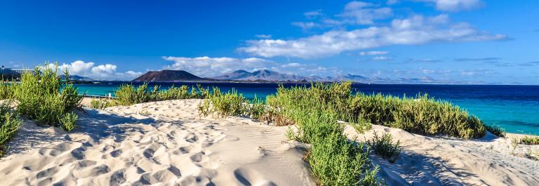 lobos-and-lanzarote-seen-from-corralejo-beach-fuerteventura-istock_000048832316_large-2